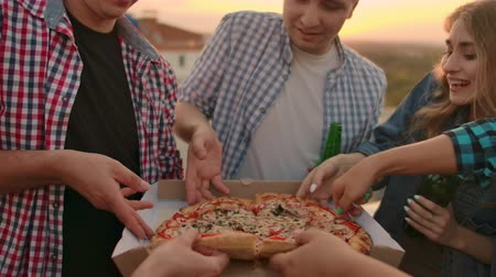 seis : Close-ups Friends eating pizza together slow motion Vídeos