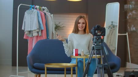 rubor : female fashion blogger recording make up tutorial to share on social media in vlog.