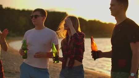 friendship dance : Dancing on the beach at sunset Stock Footage