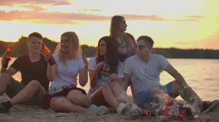 orange t shirt : The best party around bonfire with orange sky Stock Footage