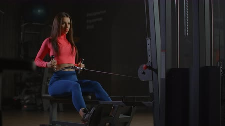 pumping : Workout woman cross training exercising cardio using rowing machine in fitness gym
