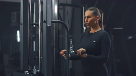 crossover : Arm muscle training for a strong triceps in gym Stock Footage