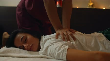 calming down : Thai massage. The asian woman rubbed by traditional chiropractor on his back with the hands to relieve tension or pain.