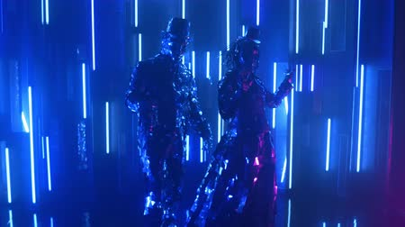 abilities : Neon light couple metallic shiny couple dancing together. Modern glass people, showcases the show in neon blue pink light. A funny dance. Music screensaver for the club.
