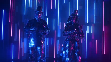 výstřední : Funny and cheerful dancers in sparkling costumes reflecting the light synchronously dance on the background of a neon wall Dostupné videozáznamy