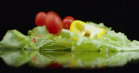 kuşkonmaz : In slow motion, sliced ​​ingredients of fresh veggie salad with water splashes fall. Ingredients of vegetarian salad fall down in slow motion. Spring onions, parsley and dill.