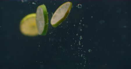 citrón : Lime rings Underwater with air bubbles and in slow motion. Fresh and juicy healthy vegetarian.