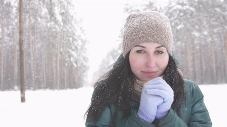 don : brunette girl in winter forest looking at camera, snow