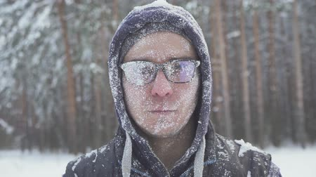 rampouch : a frozen man with glasses in the winter forest, after a snow storm, covered with snow