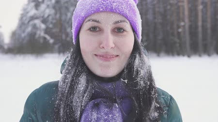иней : girl in the winter forest after a snow storm runs up to the camera covered with snow