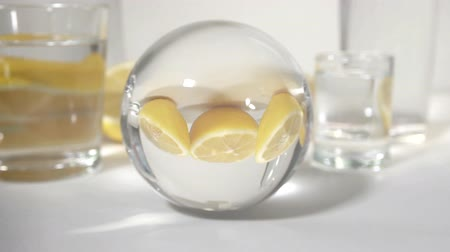 cítrico : reflection in a glass ball yellow owls cut lemons on a white background