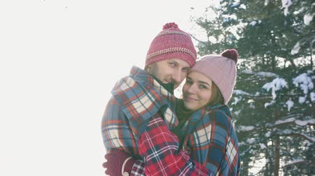 knitted : girl and guy in the arms of a sunny day winter forest, checkered red plaid