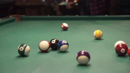 breaks balls in billiards