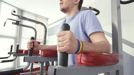 a man with a bracelet lgbt engaged in the gym Wideo