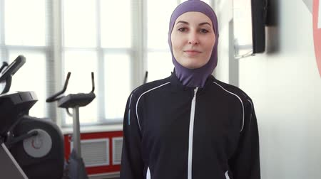 aerobic : portrait of a sporty woman in hijab in the gym