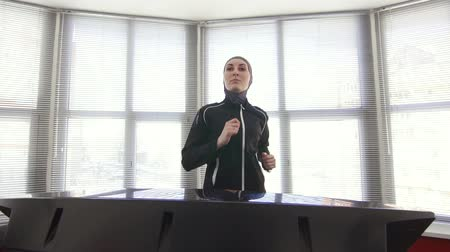 girl in a sportswoman in hijab on a running fitness machine fitness training Wideo