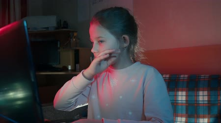 intrigue : little girl sitting at the computer crying
