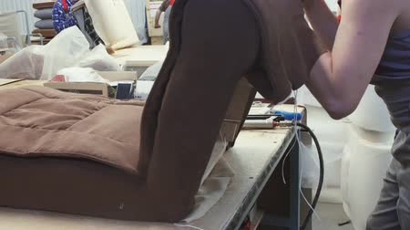 sponka : the hands of the worker in the production of armchairs