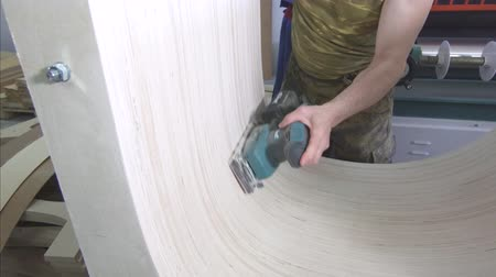 dungarees : man works as a wood grinder Stock Footage