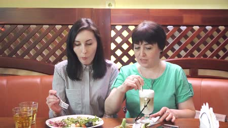scrapbook : Mom and daughter at the table are eating and talking