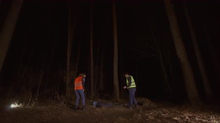 serial : man and woman volunteers in a reflective waistcoat found a corpse in the forest