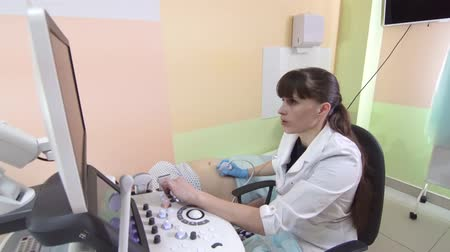 sonography : Skillful sonographer using ultrasound machine at work