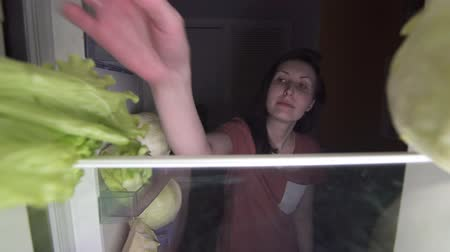 cukorbaj : dissatisfied girl on a diet eating salad at night, hunger