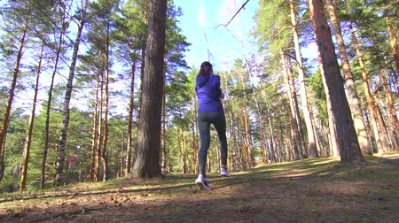 cross training : girl on a run in a sunny forest dolly shot