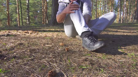 şişme : man injury while jogging in the forest sun, ankle sprain
