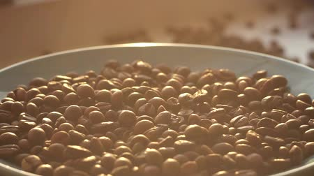 brew coffee : coffee beans on a plate rotation, sun in the morning Stock Footage