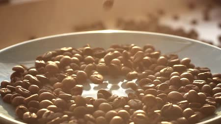 brazil : Brown roasted coffee beans falling on pile