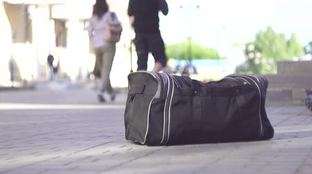 megolvad : left bag on the street, terrorist attack close up slow mo