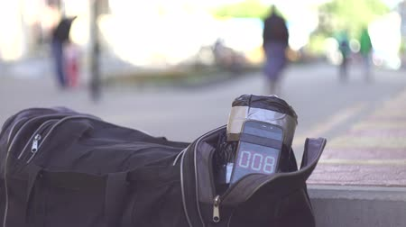 fuse : bag with a bomb on the street, a ticking timer close up