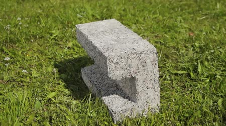 press wall : building cement block on grass