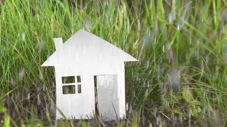 bad ecology : cardboard house of paper is destroyed in the rain Stock Footage