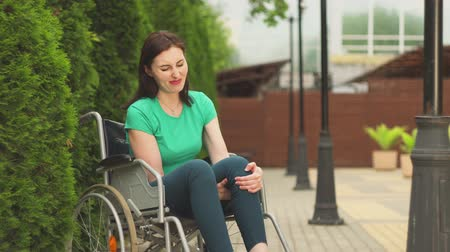 improve : young girl in a wheelchair trying to get up Stock Footage