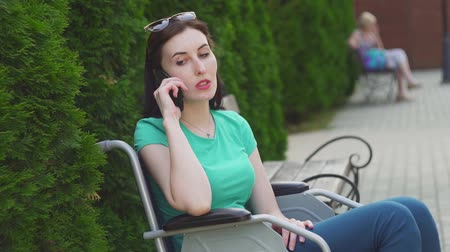 inwalida : Attractive girl in a wheelchair speaks on the phone