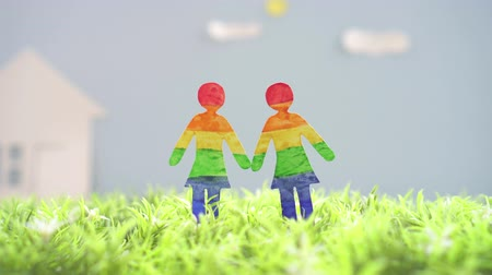 sexo : LGBT concept idea, two lesbian girls on green grass Vídeos