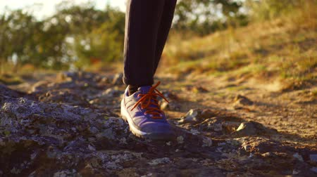 cross country : feet walking man close-up on a Sunny day for a walk Stock Footage