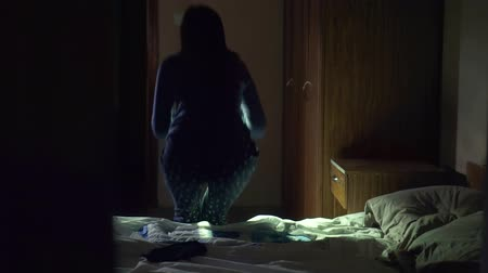 thieve : Sleeping girl the night I heard sounds and went to look with flashlight Stock Footage