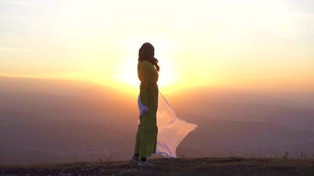 palestina : portrait of a beautiful girl in hijab at sunset in the mountains