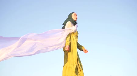 palestina : portrait of a stylish girl in a hijab at sunset in the mountains