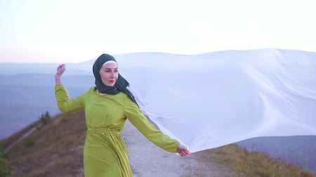 palestina : fabric in the wind in the hands of a Muslim beautiful woman model