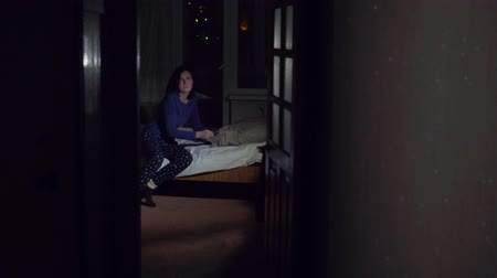 thieve : Girl half asleep heard a noise in the apartment and went to look with flashlight,concept thief Stock Footage
