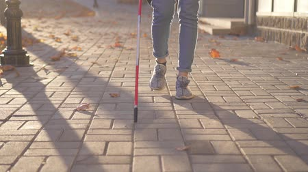 blindness : Close up of a woman with a cane for the visually impaired is in the city ,slow mo