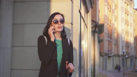 blindness : Blind woman standing on the street with a cane in his hand and talking on the phone Stock Footage