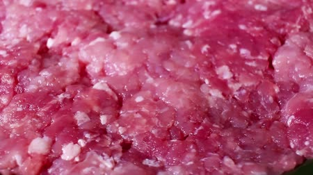 Minced meat pig pork meat rotating food texture closeup video footage. Studio lighting.