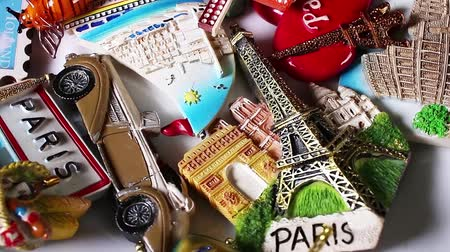 Tourism concept Travelling souvenirs Paris Holland fridge magnets Стоковые видеозаписи