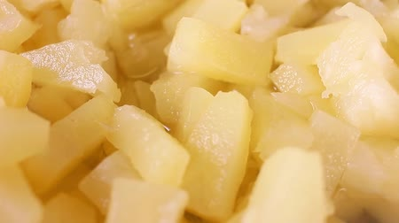 Pineapple slices rotating food texture closeup video footage. Studio lighting. Стоковые видеозаписи
