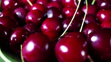 Red sweet cherry background rotating food texture closeup video footage. Studio lighting.